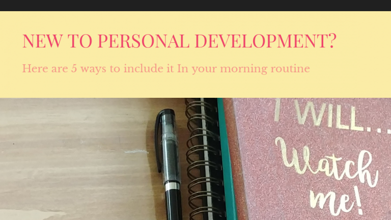 Personal development notebooks and a pen