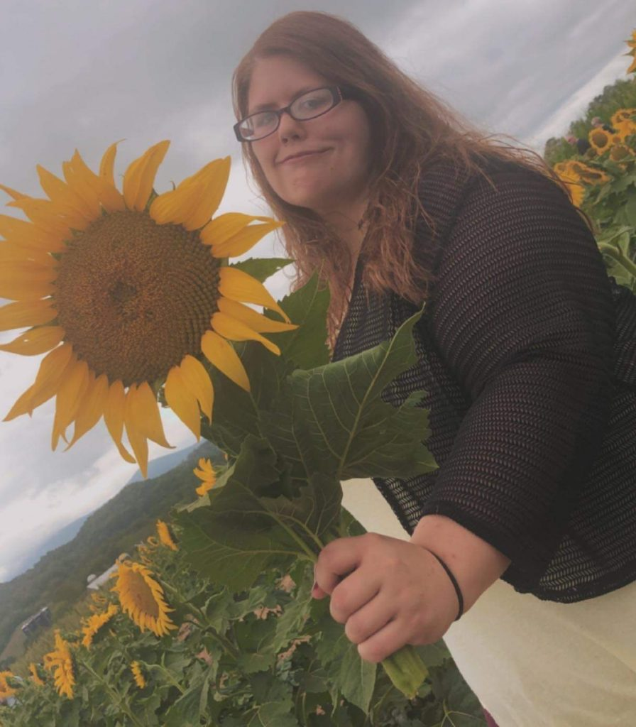me in a sunflower feild for about me page